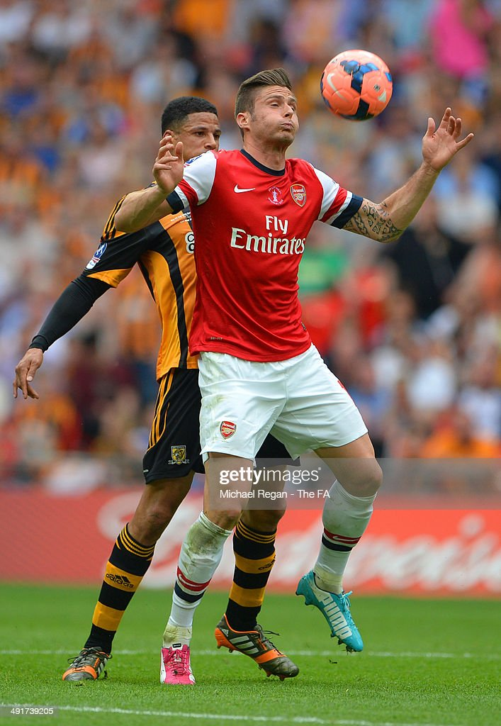 Olivier Giroud of Arsenal battles for the ball with Curtis Davies of Hull City during the FA Cup with Budweiser Final match between Arsenal and Hull City at Wembley Stadium on May 17, 2014 in London, England.