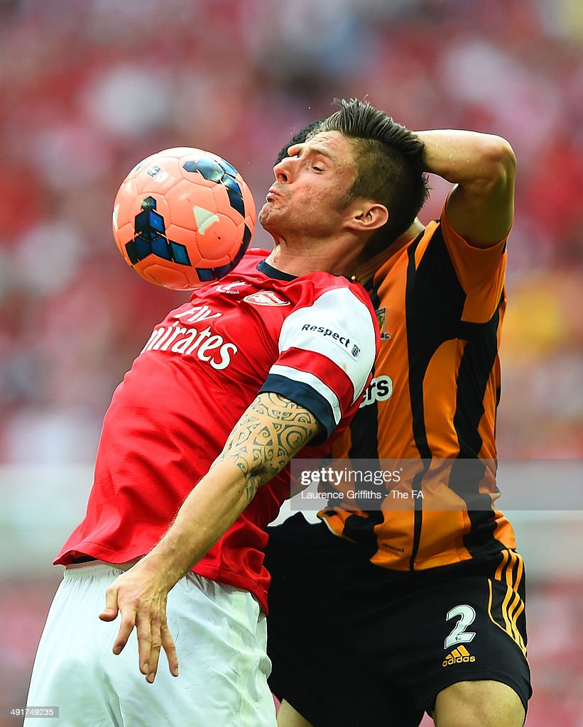 Olivier Giroud of Arsenal battles for the ball with Liam Rosenior of Hull City during the FA Cup with Budweiser Final match between Arsenal and Hull City at Wembley Stadium on May 17, 2014 in London, England.