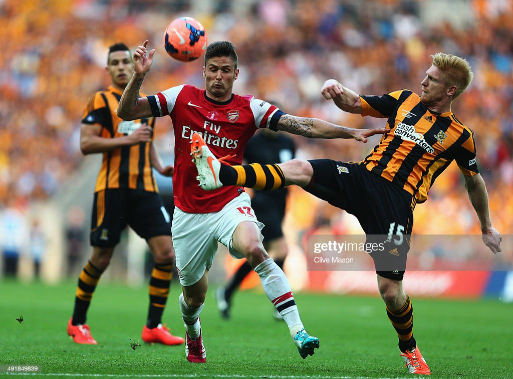 Olivier Giroud of Arsenal battles with Paul McShane of Hull City during the FA Cup with Budweiser Final match between Arsenal and Hull City at Wembley Stadium on May 17, 2014 in London, England.