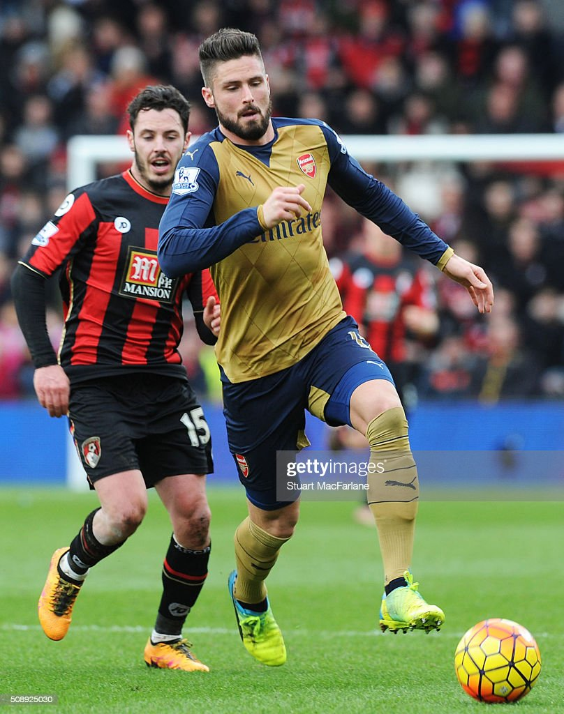 <a gi-track='captionPersonalityLinkClicked' href=/galleries/search?phrase=Olivier+Giroud&family=editorial&specificpeople=5678034 ng-click='$event.stopPropagation()'>Olivier Giroud</a> of Arsenal breaks past <a gi-track='captionPersonalityLinkClicked' href=/galleries/search?phrase=Adam+Smith+-+Soccer+Right+Back&family=editorial&specificpeople=14054674 ng-click='$event.stopPropagation()'>Adam Smith</a> of Bournemouth during the Barclays Premier League match between AFC Bournemouth and Arsenal at The Vitality Stadium on February 7, 2016 in Bournemouth, England. (Photo by Stuart MacFarlane/Arsenal FC via Getty Images