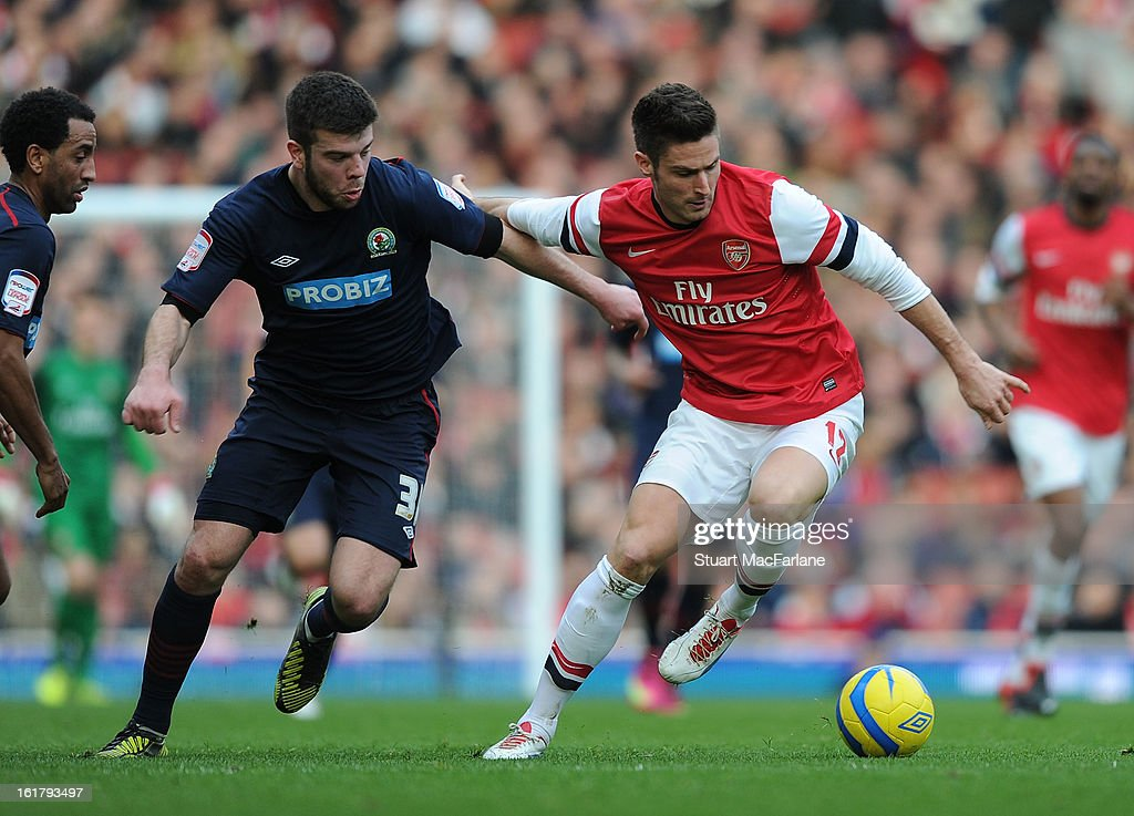 Olivier Giroud of Arsenal breaks past Grant Hanley of Blackburn during the FA Cup Fifth Round match between Arsenal and Blackburn Rovers at the Emirates Stadium on February 16, 2013 in London, England.