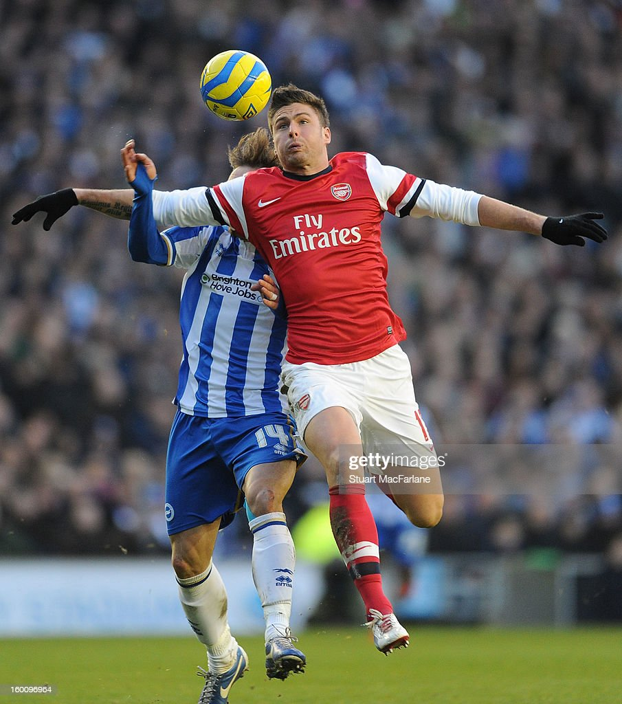 Olivier Giroud of Arsenal breaks past Inigo Calderon of Brighton during the FA Cup Fourth Round match between Brighton & Hove Albion and Arsenal at the Amex Stadium on January 26, 2013 in Brighton, England.