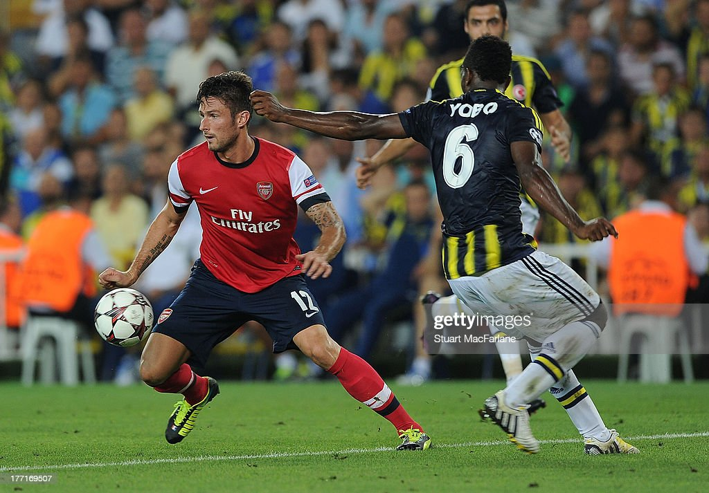 <a gi-track='captionPersonalityLinkClicked' href=/galleries/search?phrase=Olivier+Giroud&family=editorial&specificpeople=5678034 ng-click='$event.stopPropagation()'>Olivier Giroud</a> of Arsenal breaks past <a gi-track='captionPersonalityLinkClicked' href=/galleries/search?phrase=Joseph+Yobo&family=editorial&specificpeople=220395 ng-click='$event.stopPropagation()'>Joseph Yobo</a> during the UEFA Champions League Play Off first leg match between Fenerbache SK and Arsenal FC at sukru Saracoglu Stadium on August 21, 2013 in Istanbul, Turkey.