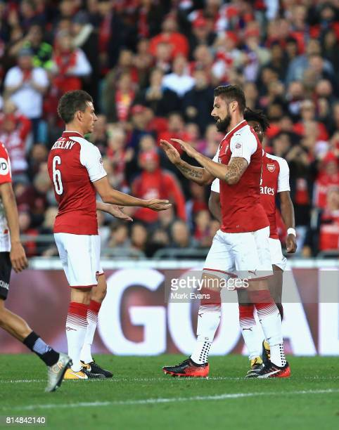 Olivier Giroud of Arsenal celebrates a goal with Laurent Koscielny of Arsenal during the match between the Western Sydney Wanderers and Arsenal FC at...