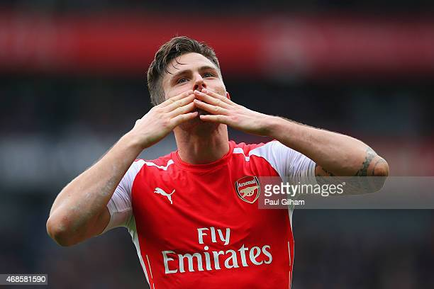 Olivier Giroud of Arsenal celebrates afteer scoring his team's fourth goal during the Barclays Premier League match between Arsenal and Liverpool at...