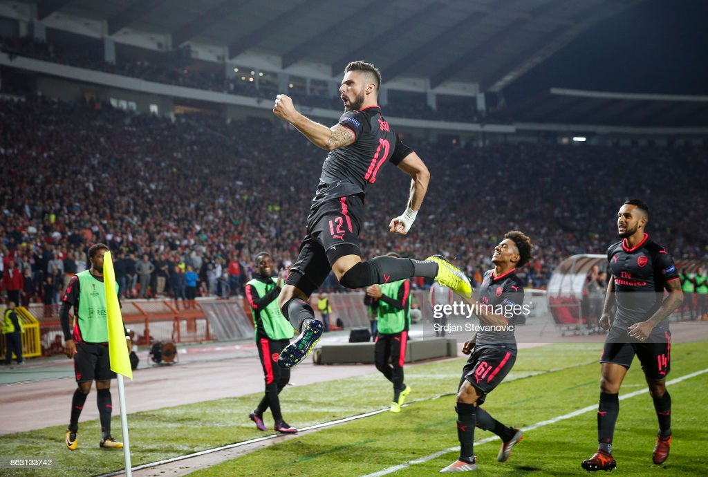 Olivier Giroud (L) of Arsenal celebrates after scoring a goal during the UEFA Europa League group H match between Crvena Zvezda and Arsenal FC at Rajko Mitic Stadium on October 19, 2017 in Belgrade, Serbia.