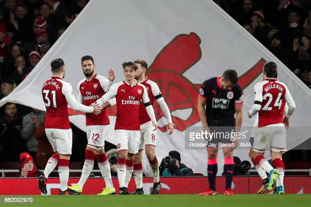 Olivier Giroud of Arsenal celebrates after scoring a goal to make it 30 during the Premier League match between Arsenal and Huddersfield Town at...