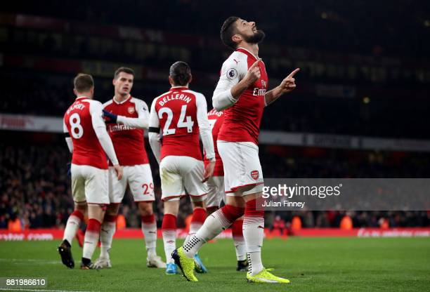 Olivier Giroud of Arsenal celebrates after scoring his sides fifth goal during the Premier League match between Arsenal and Huddersfield Town at...