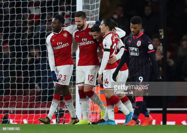 Olivier Giroud of Arsenal celebrates after scoring his sides fifth goal with Danny Welbeck of Arsenal and Hector Bellerin of Arsenal during the...