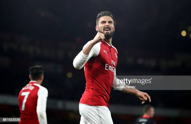 Olivier Giroud of Arsenal celebrates after scoring his sides second goal during the Premier League match between Arsenal and Huddersfield Town at...