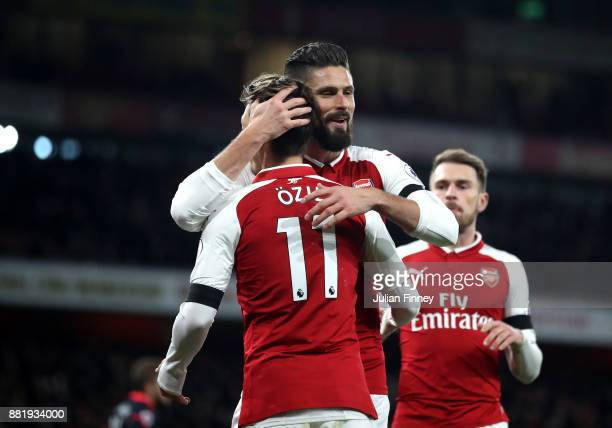Olivier Giroud of Arsenal celebrates after scoring his sides second goal with Mesut Ozil of Arsenal during the Premier League match between Arsenal...
