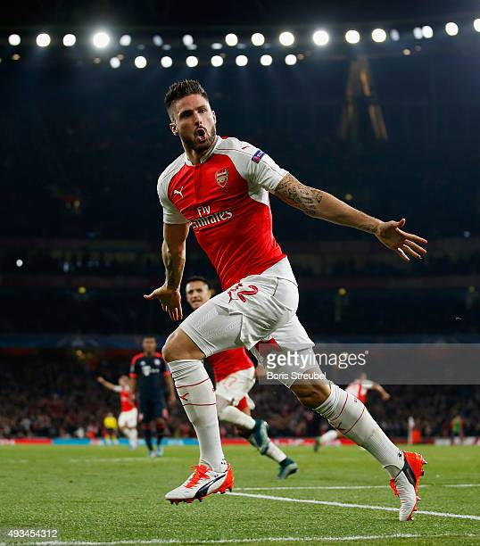 Olivier Giroud of Arsenal celebrates after scoring his team's first goal during the UEFA Champions League Group F match between Arsenal FC and FC...