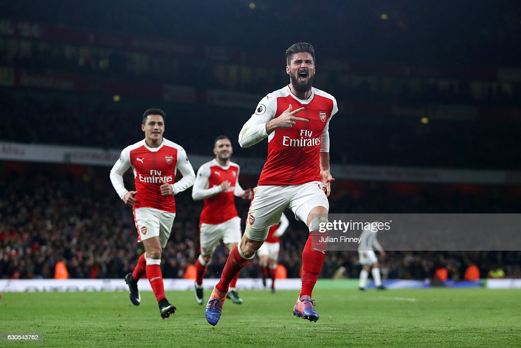Olivier Giroud of Arsenal celebrates after scoring the opening goal during the Premier League match between Arsenal and West Bromwich Albion at Emirates Stadium on December 26, 2016 in London, England.