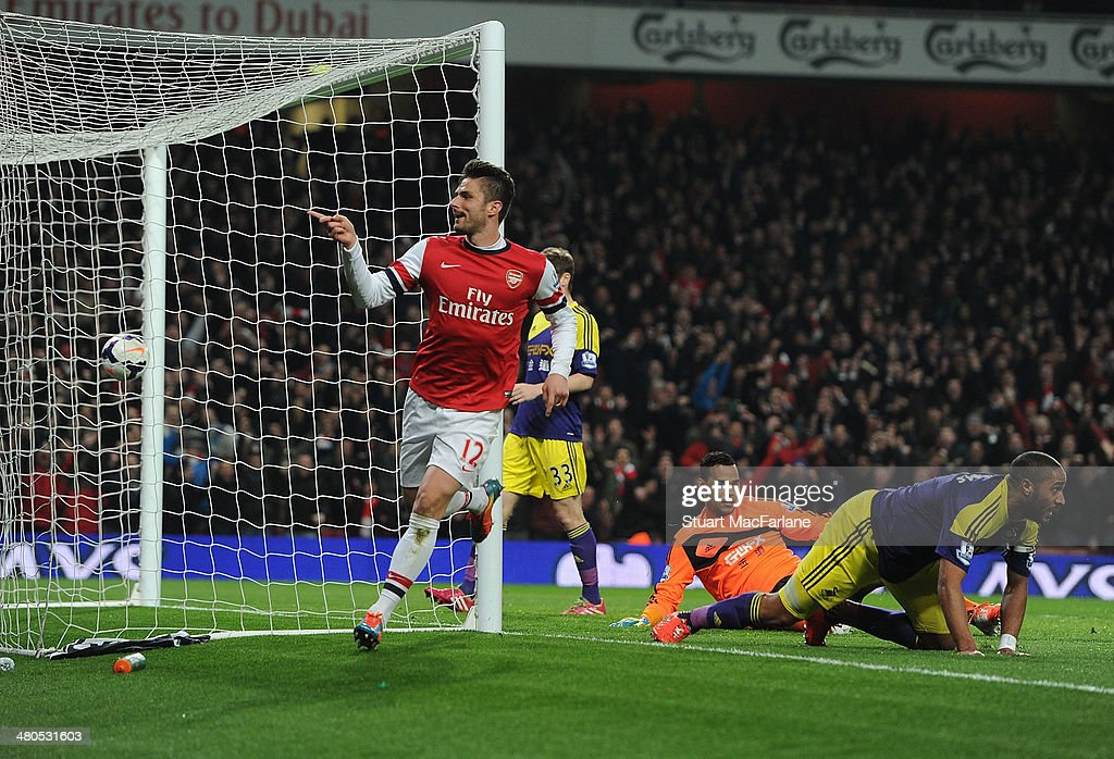 Olivier Giroud of Arsenal celebrates after scoring their second goal during the Barclays Premier League match between Arsenal and Swansea City at Emirates Stadium on March 25, 2014 in London, England.