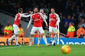 Olivier Giroud of Arsenal celebrates after scoring to make it 20 during the Barclays Premier League match between Arsenal and Manchester City at the...
