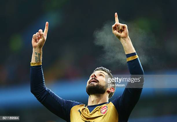 Olivier Giroud of Arsenal celebrates as he scores their first goal from a penalty during the Barclays Premier League match between Aston Villa and...