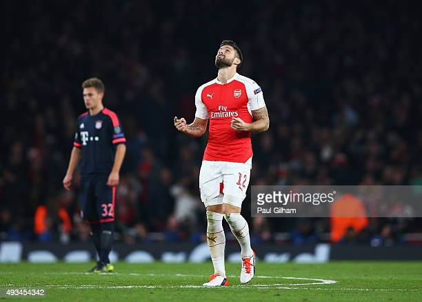 Olivier Giroud of Arsenal celebrates as he scores their first goal during the UEFA Champions League Group F match between Arsenal FC and FC Bayern...