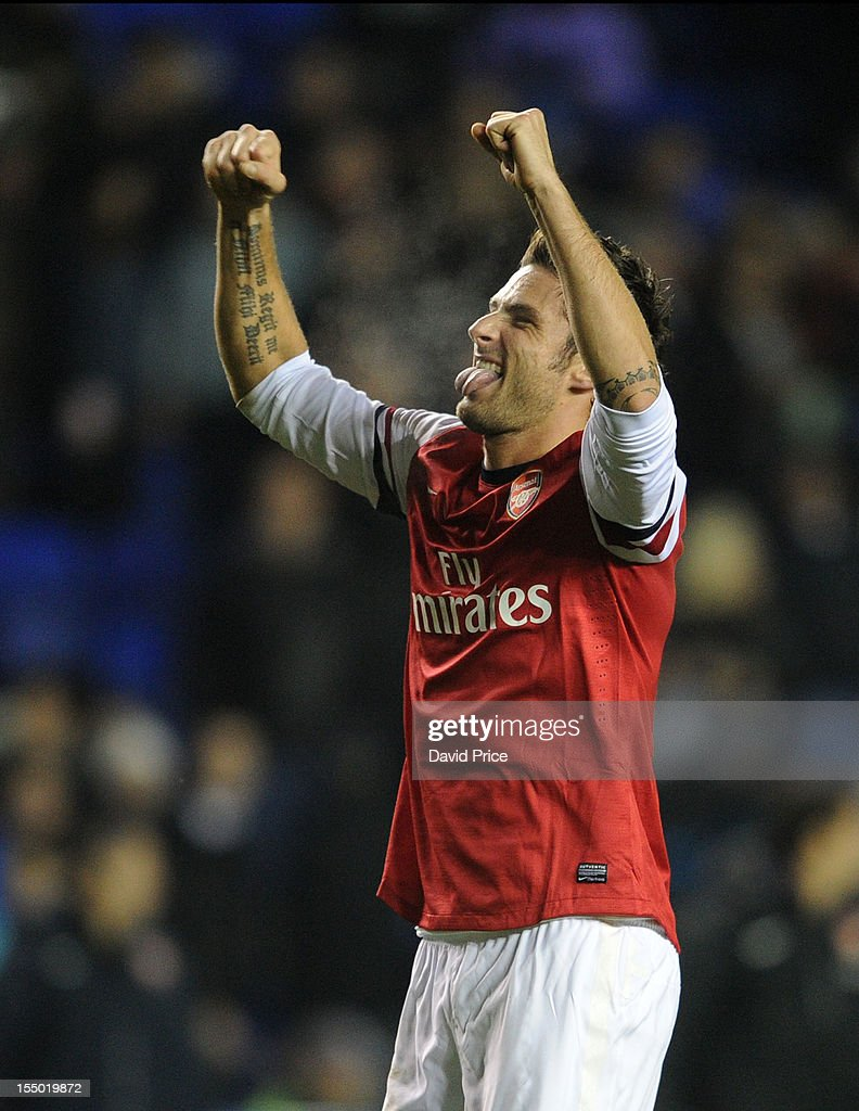 Olivier Giroud of Arsenal celebrates at the end of the 90 minutes during the Capital One Cup match between Arsenal and Reading at Madejski Stadium on October 30, 2012 in Reading, England.