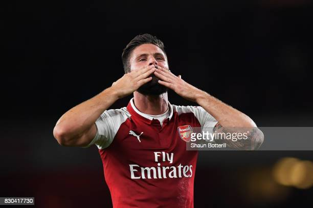 Olivier Giroud of Arsenal celebrates following his team's 43 victory during the Premier League match between Arsenal and Leicester City at the...