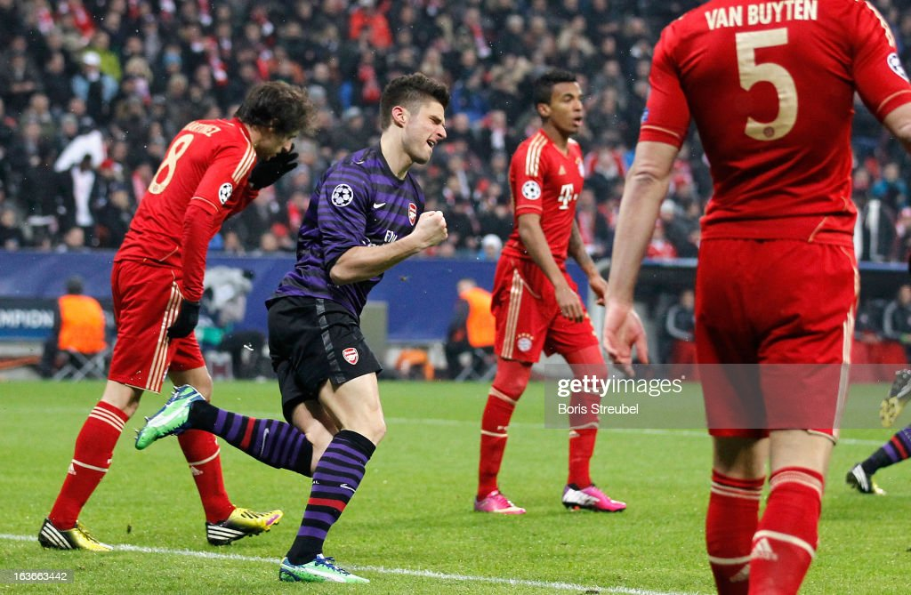 <a gi-track='captionPersonalityLinkClicked' href=/galleries/search?phrase=Olivier+Giroud&family=editorial&specificpeople=5678034 ng-click='$event.stopPropagation()'>Olivier Giroud</a> of Arsenal (C) celebrates his team's first goal during the UEFA Champions League Round of 16 second leg match between Bayern Muenchen and Arsenal FC at Allianz Arena on March 13, 2013 in Munich, Germany.