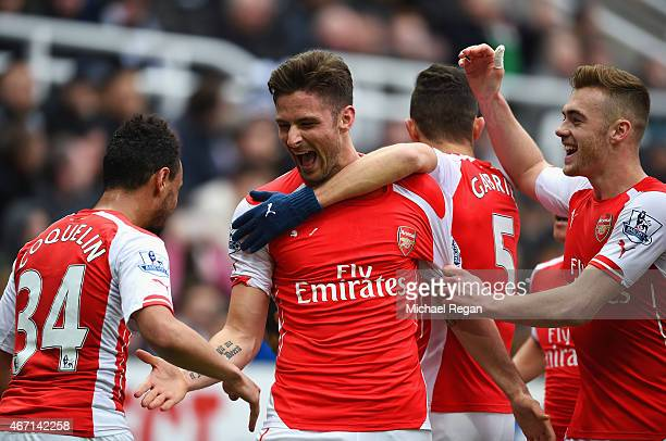 Olivier Giroud of Arsenal celebrates scoring his second goal with Francis Coquelin and Calum Chambers of Arsenal during the Barclays Premier League...