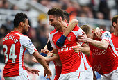 Olivier Giroud of Arsenal celebrates scoring his second goal with Francis Coquelin during the Barclays Premier League match between Newcastle United...