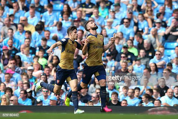 Olivier Giroud of Arsenal celebrates scoring his side's first goal with Gabriel Paulista of Arsenal during the Barclays Premier League match between...
