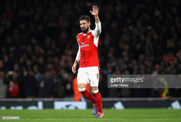 Olivier Giroud of Arsenal celebrates scoring his sides first goal during the UEFA Champions League Group A match between Arsenal FC and Paris...