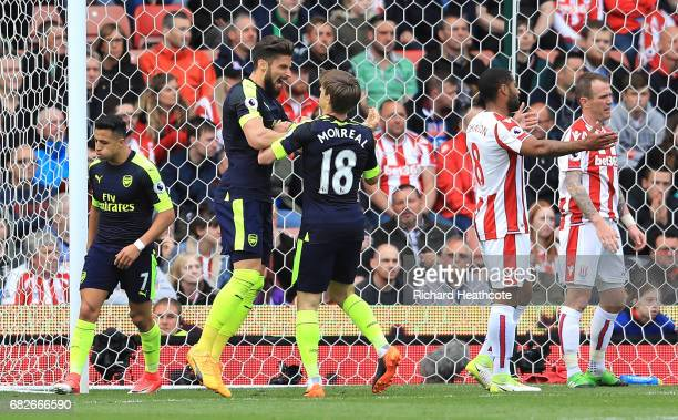 Olivier Giroud of Arsenal celebrates scoring his sides first goal with Nacho Monreal of Arsenal during the Premier League match between Stoke City...