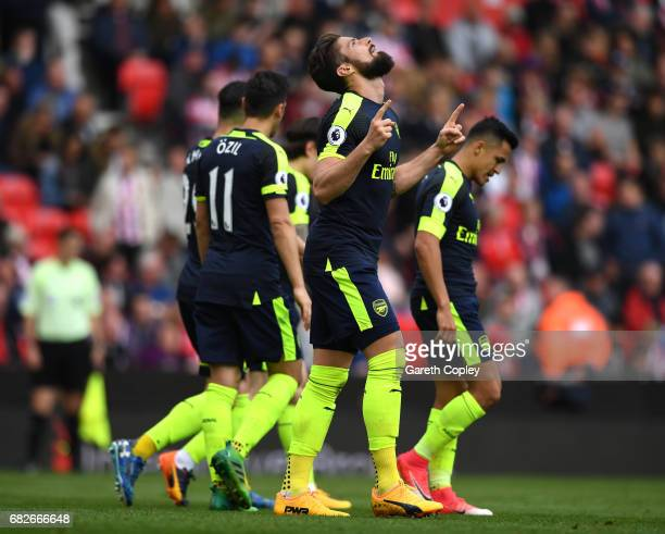 Olivier Giroud of Arsenal celebrates scoring his sides first goal during the Premier League match between Stoke City and Arsenal at Bet365 Stadium on...