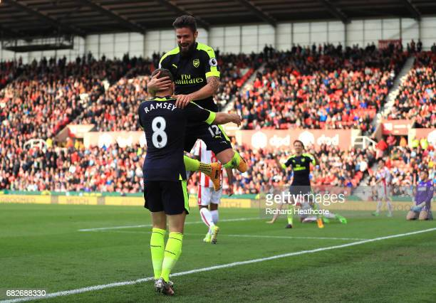 Olivier Giroud of Arsenal celebrates scoring his sides fourth goal with Aaron Ramsey of Arsenal during the Premier League match between Stoke City...