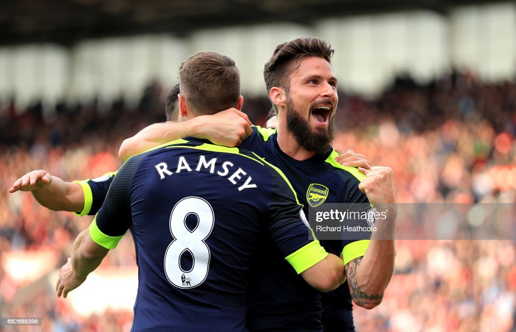 Olivier Giroud of Arsenal celebrates scoring his sides fourth goal with Aaron Ramsey of Arsenal during the Premier League match between Stoke City and Arsenal at Bet365 Stadium on May 13, 2017 in Stoke on Trent, England.