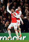 Olivier Giroud of Arsenal celebrates scoring his side's second goal with Aaron Ramsey of Arsenal during the Barclays Premier League match between...