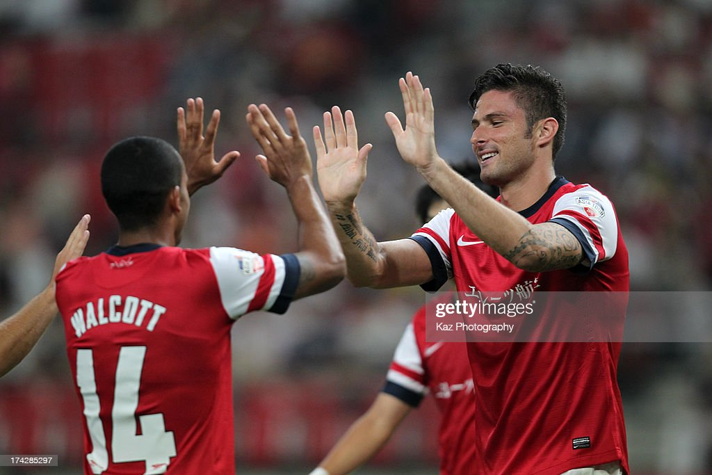 <a gi-track='captionPersonalityLinkClicked' href=/galleries/search?phrase=Olivier+Giroud&family=editorial&specificpeople=5678034 ng-click='$event.stopPropagation()'>Olivier Giroud</a> (R) of Arsenal celebrates scoring his team's first goal with his team mate <a gi-track='captionPersonalityLinkClicked' href=/galleries/search?phrase=Theo+Walcott&family=editorial&specificpeople=451535 ng-click='$event.stopPropagation()'>Theo Walcott</a> during the pre-season friendly match between Nagoya Grampus and Arsenal at Toyota Stadium on July 22, 2013 in Toyota, Aichi, Japan.
