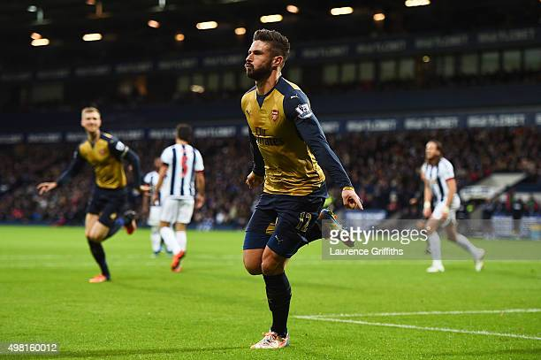 Olivier Giroud of Arsenal celebrates scoring his team's first goal during the Barclays Premier League match between West Bromwich Albion and Arsenal...