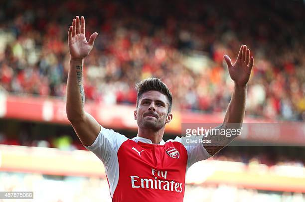 Olivier Giroud of Arsenal celebrates scoring his team's second goal during the Barclays Premier League match between Arsenal and Stoke City at the...