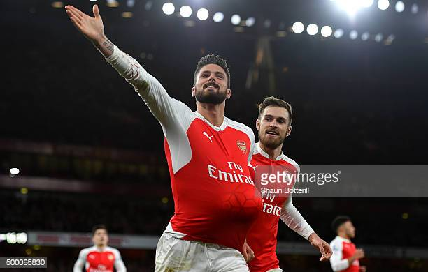 Olivier Giroud of Arsenal celebrates scoring his team's second goal with his team mate Aaron Ramsey during the Barclays Premier League match between...