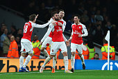 Olivier Giroud of Arsenal celebrates scoring his team's second goal with team mates during the Barclays Premier League match between Arsenal and...
