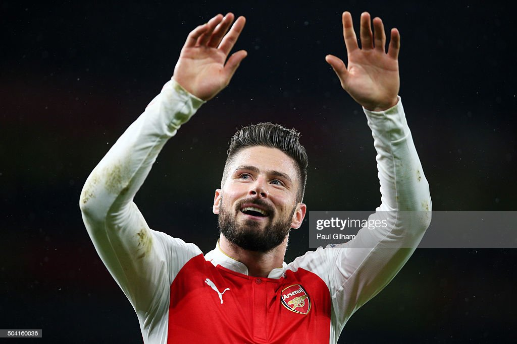 Olivier Giroud of Arsenal celebrates scoring his team's third goal during the Emirates FA Cup Third Round match between Arsenal and Sunderland at Emirates Stadium on January 9, 2016 in London, England.