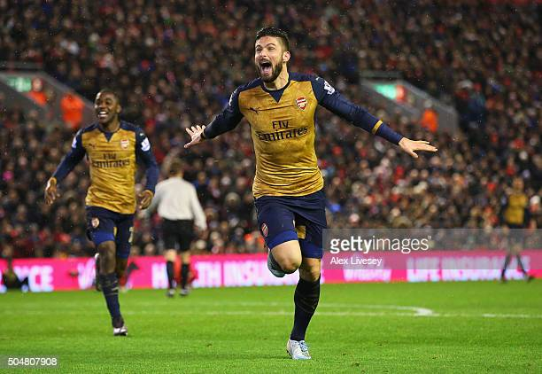 Olivier Giroud of Arsenal celebrates scoring his team's third goal during the Barclays Premier League match between Liverpool and Arsenal at Anfield...
