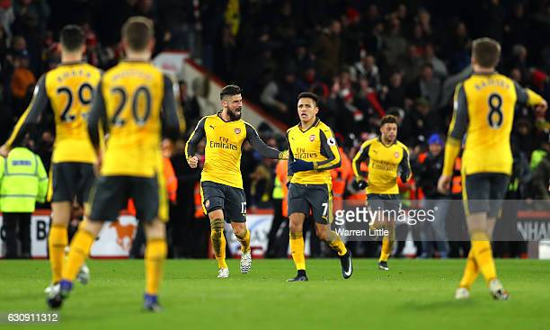 Olivier Giroud of Arsenal celebrates scoring his team's third goal with his team mate Alexis Sanchez during the Premier League match between AFC...