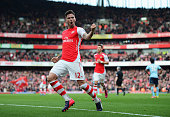 Olivier Giroud of Arsenal celebrates scoring the opening goal during the Barclays Premier League match between Arsenal and West Ham United at...
