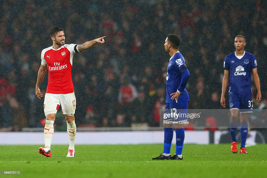 Olivier Giroud of Arsenal celebrates scoring the opening goal during the Barclays Premier League match between Arsenal and Everton at Emirates Stadium on October 24, 2015 in London, England.