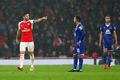 Olivier Giroud of Arsenal celebrates scoring the opening goal during the Barclays Premier League match between Arsenal and Everton at Emirates...