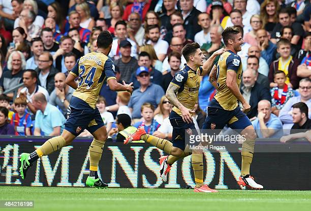 Olivier Giroud of Arsenal celebrates scoring the opening goal with team mate Hector Bellerin during the Barclays Premier League match between Crystal...
