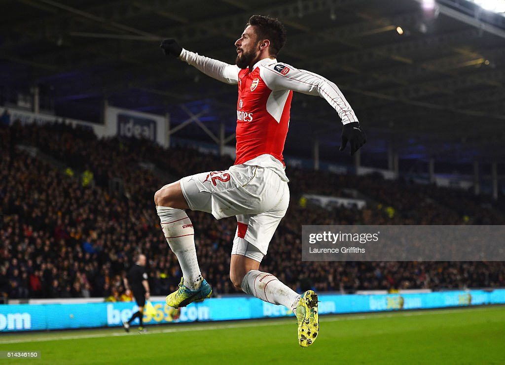 Olivier Giroud of Arsenal celebrates scoring the second Arsenal goal during the Emirates FA Cup Fifth Round Replay match between Hull City and Arsenal at KC Stadium on March 8, 2016 in Hull, England.