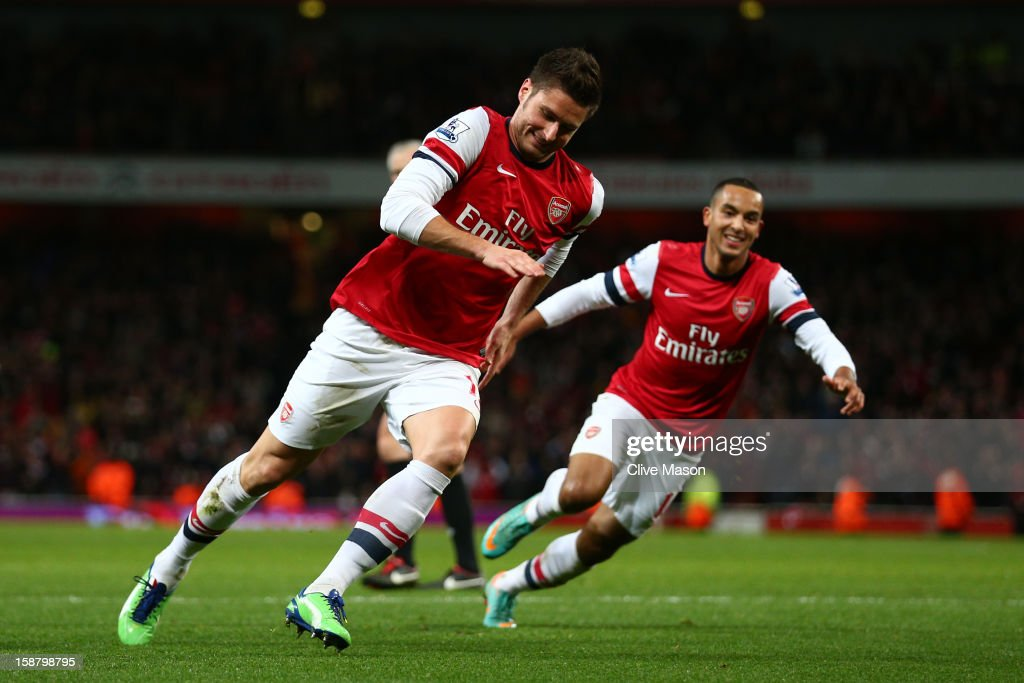 Olivier Giroud of Arsenal celebrates scoring their sixth goal with Theo Walcott of Arsenal during the Barclays Premier League match between Arsenal and Newcastle United at the Emirates Stadium on December 29, 2012 in London, England.