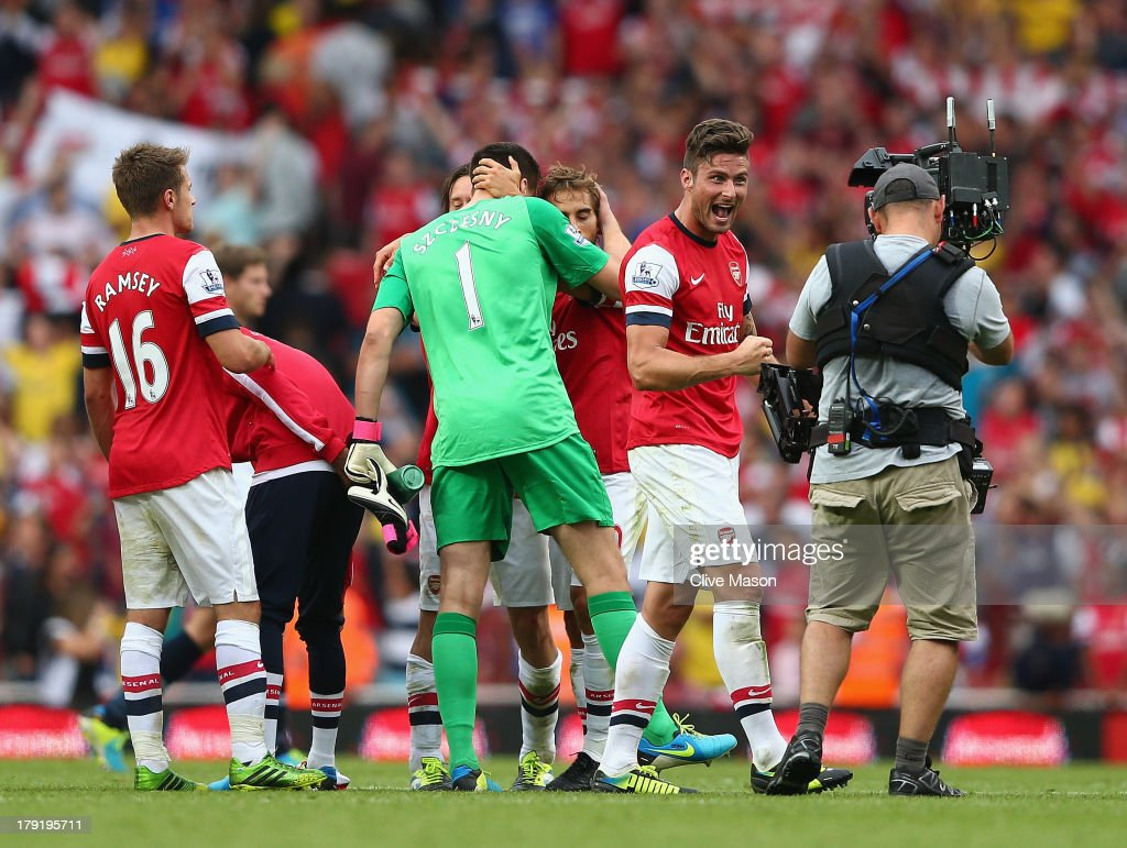 <a gi-track='captionPersonalityLinkClicked' href=/galleries/search?phrase=Olivier+Giroud&family=editorial&specificpeople=5678034 ng-click='$event.stopPropagation()'>Olivier Giroud</a> of Arsenal celebrates victory after the Barclays Premier League match between Arsenal and Tottenham Hotspur at Emirates Stadium on September 01, 2013 in London, England.