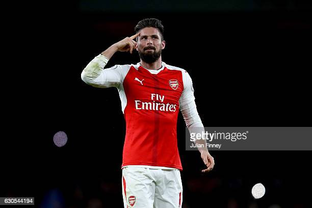 Olivier Giroud of Arsenal celebrates victory after the Premier League match between Arsenal and West Bromwich Albion at Emirates Stadium on December...