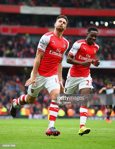 Olivier Giroud of Arsenal celebrates with Danny Welbeck of Arsenal after scoring his team's fourth goal during the Barclays Premier League match...